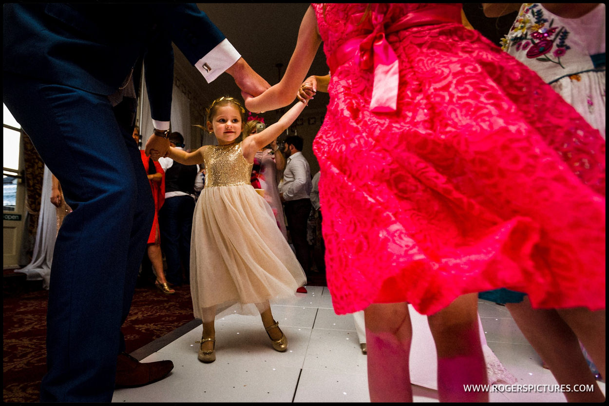 Little girl twirls her wedding dress