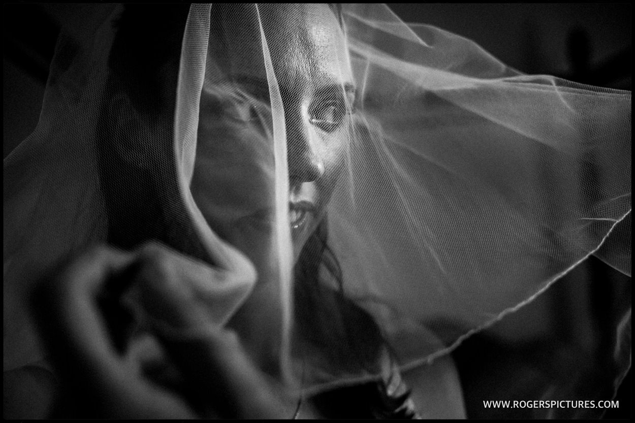 Black and white portrait of bride with veil