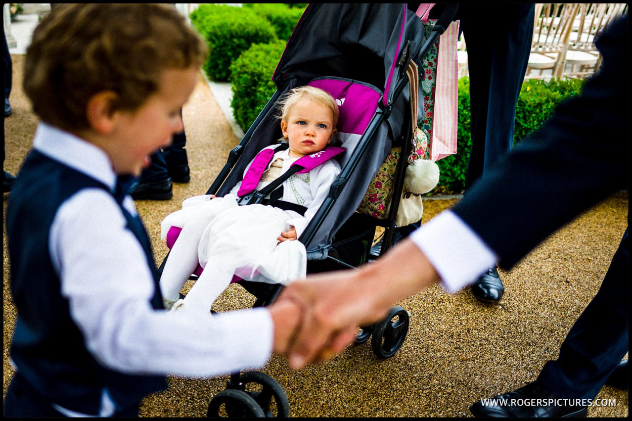 Child and pram for the wedding ceremony