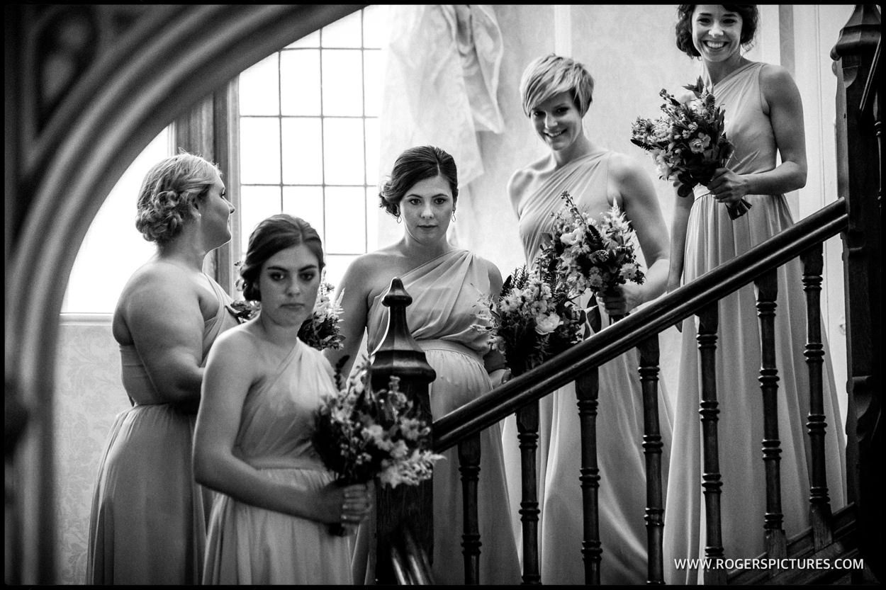 Black-and-white picture of bridesmaids on the stairway at Foyle Park
