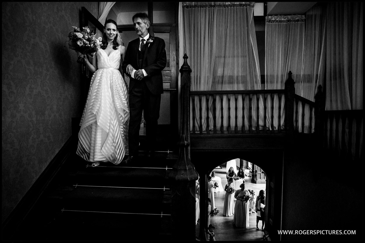 Dad and daughter walked down the stairs before the wedding ceremony