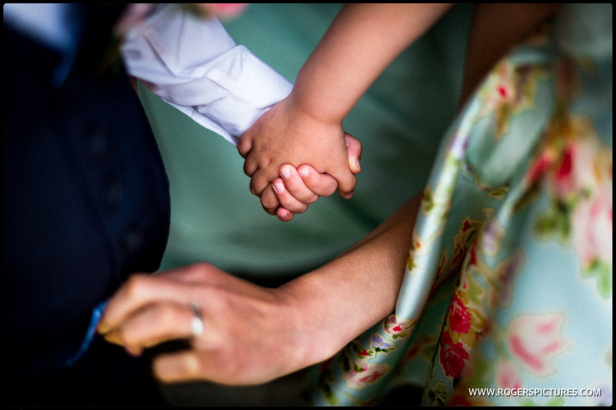 Close-up of children holding hands
