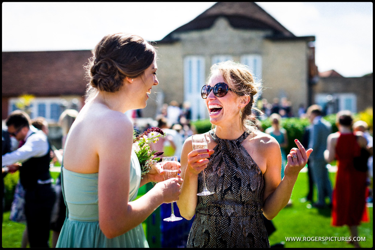 Laughing wedding guests in the sunshine