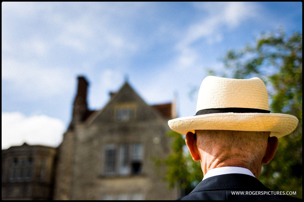 Man in a hat at some wedding