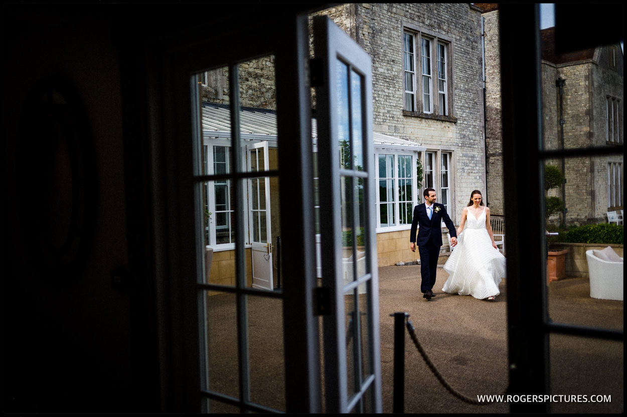 Documentary moment of bride and groom at wedding in Hampshire