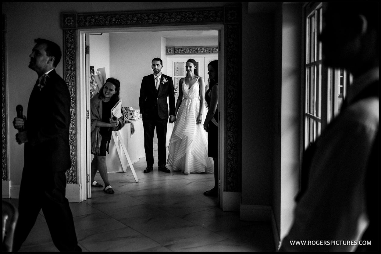 Bride and Groom wait to be announced into the wedding breakfast