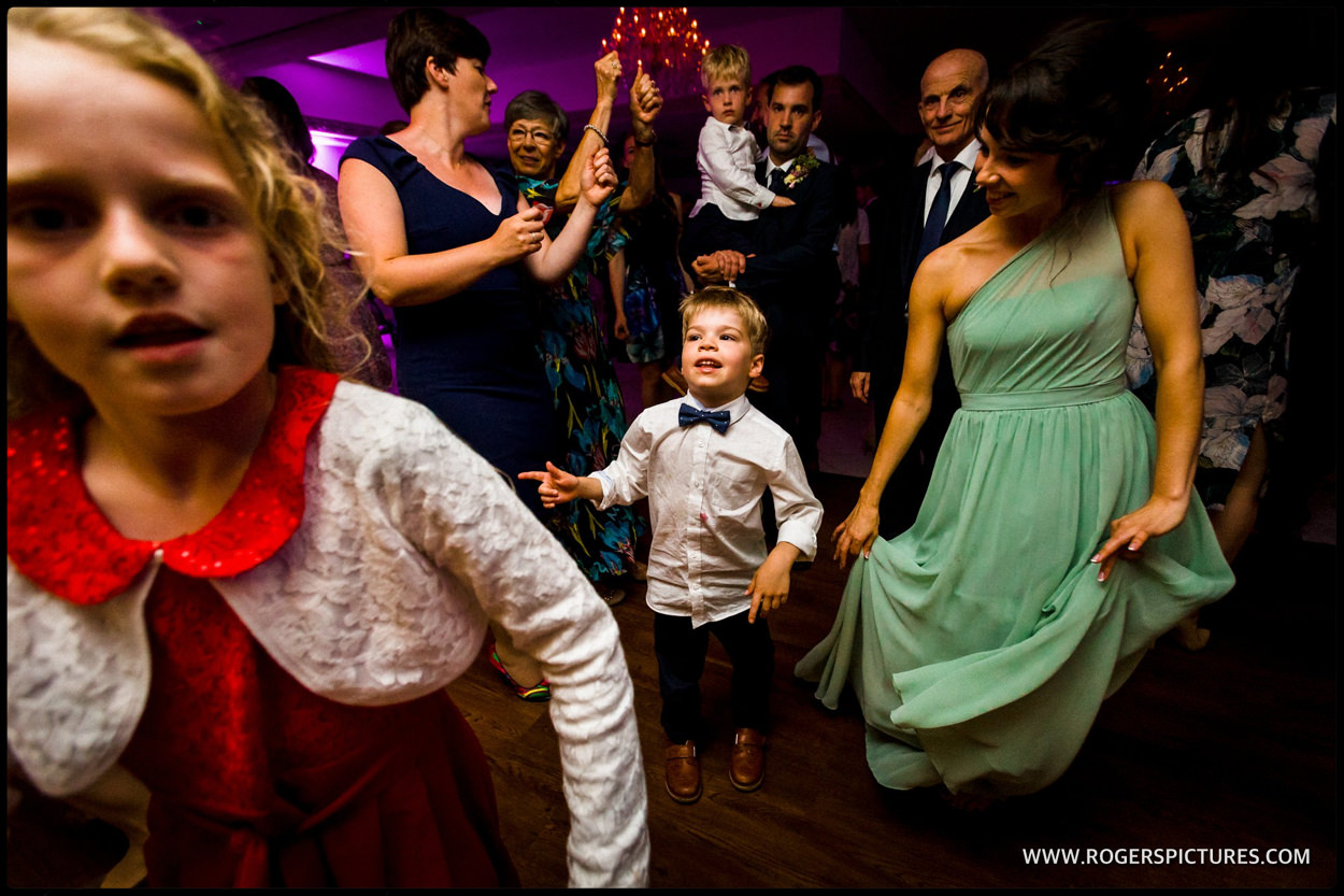 Children dancing on the dancefloor after wedding