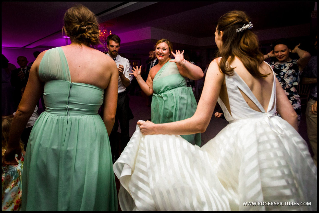 Bridesmaids dancing on the dancefloor