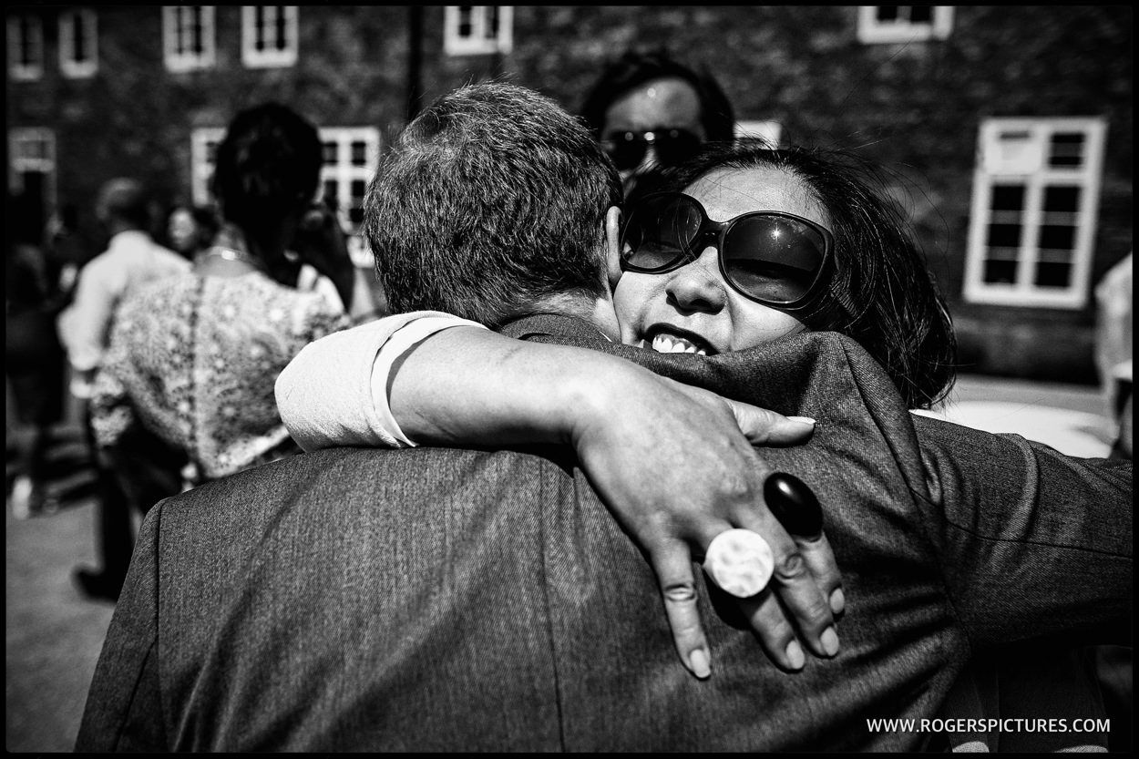Guests hugging in the courtyard at Fulham Palace