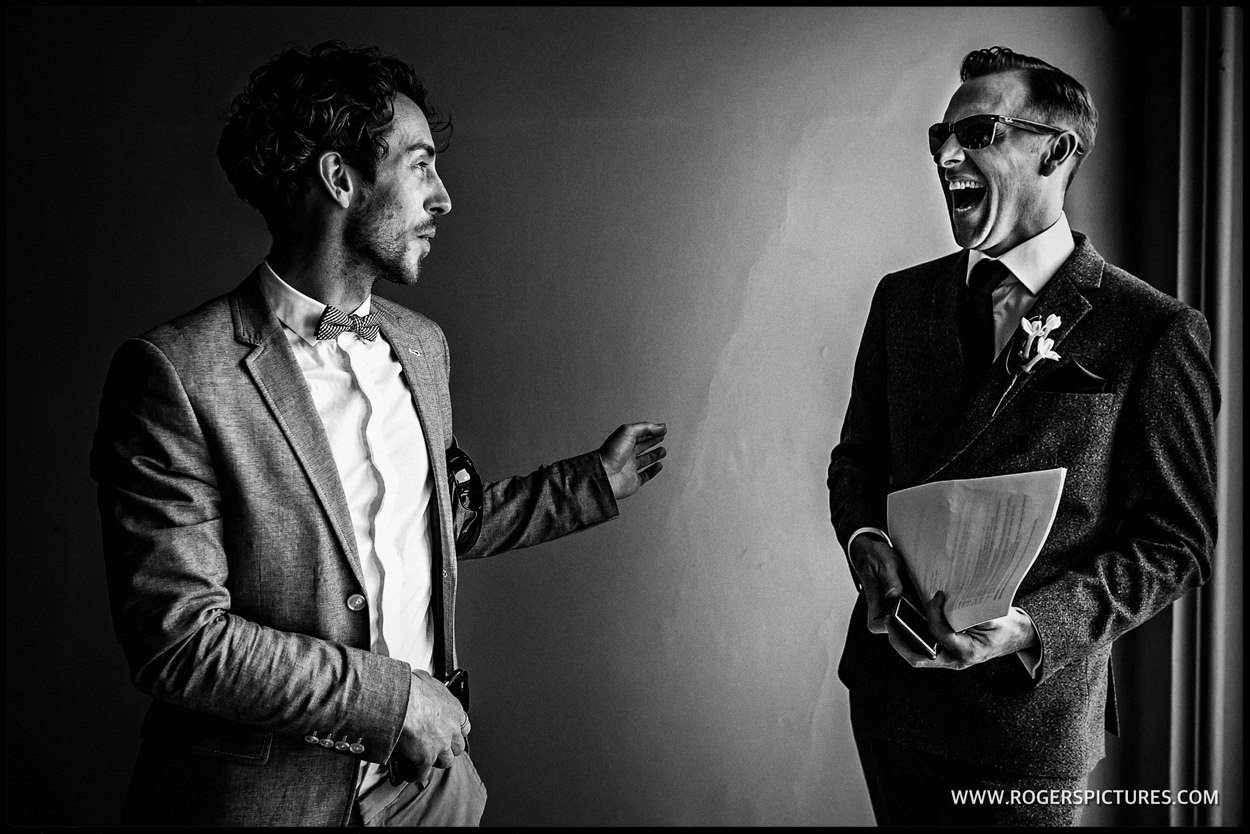 Laughing wedding guest at Fulham Palace