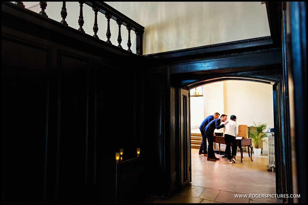 Grooms meet the registrar at gay wedding in Fulham Palace