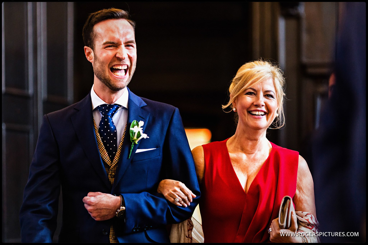 Laughing groom arrives for same-sex wedding at Fulham Palace