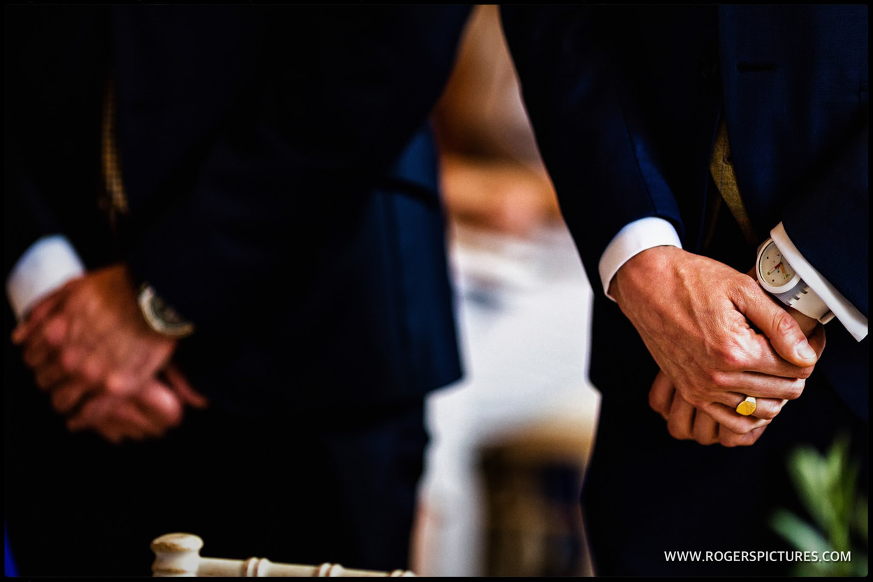 Detail of grooms hands at wedding