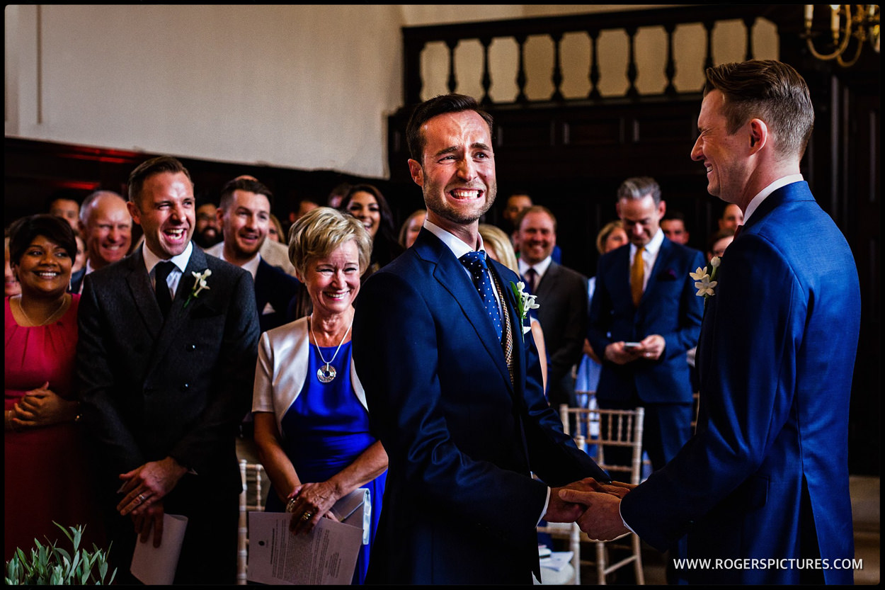 Smiling grooms during wedding ceremony