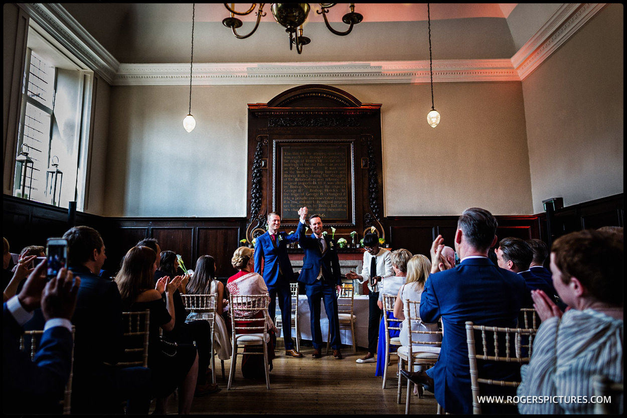 Happy grooms after getting married in the great Hall at Fulham Palace