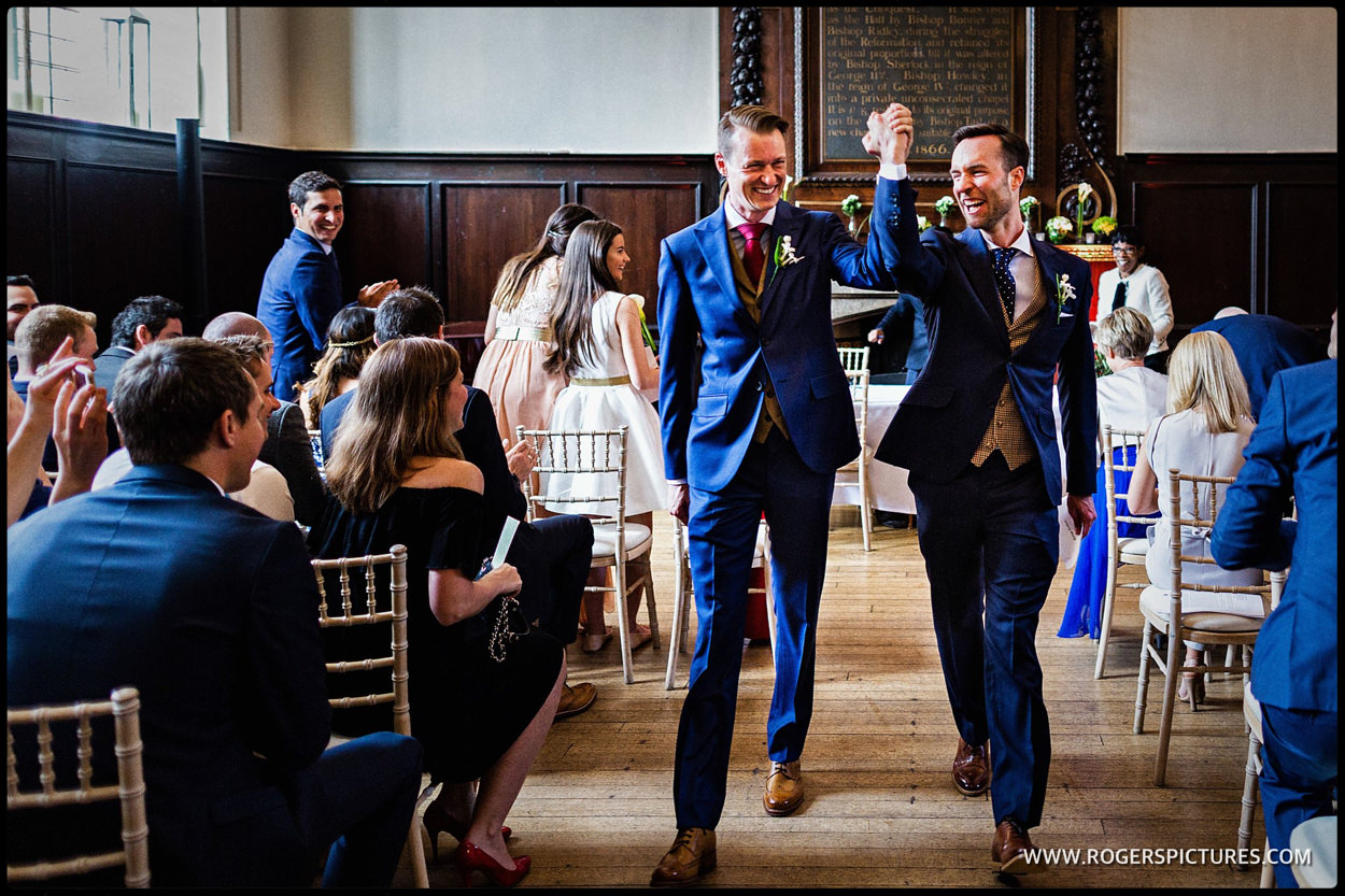 Grooms leave wedding ceremony at Fulham Palace