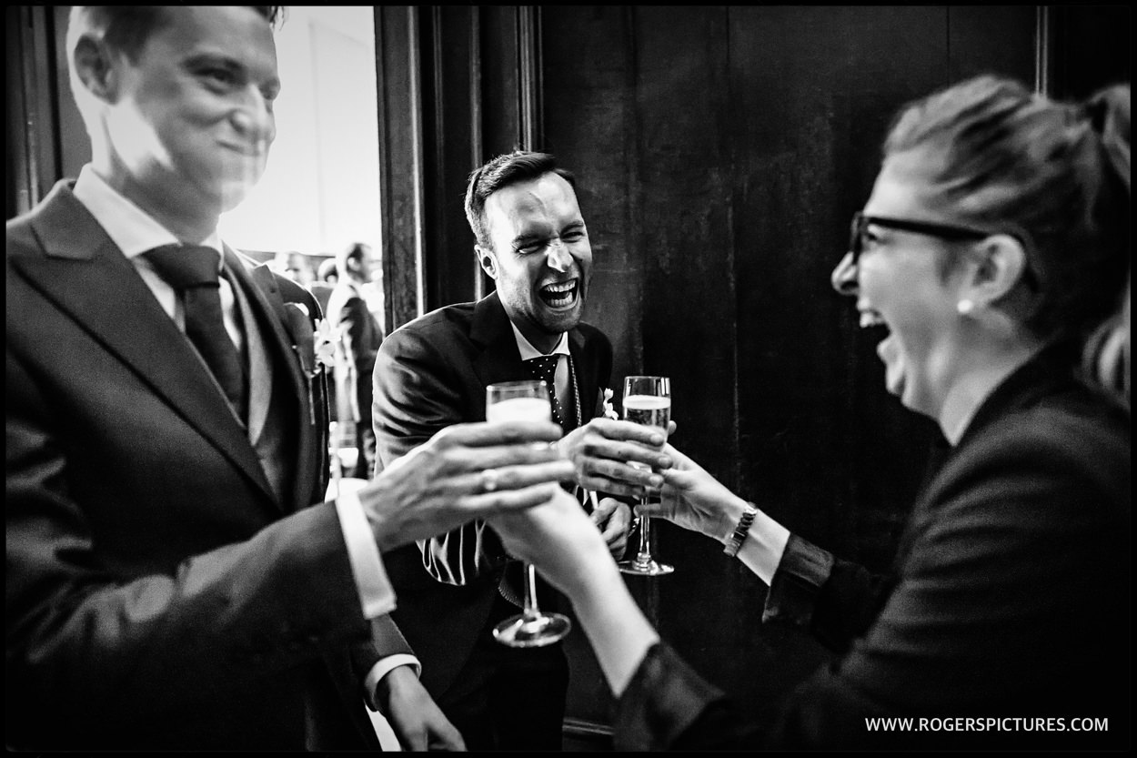 Celebration champagne drinks after gay wedding