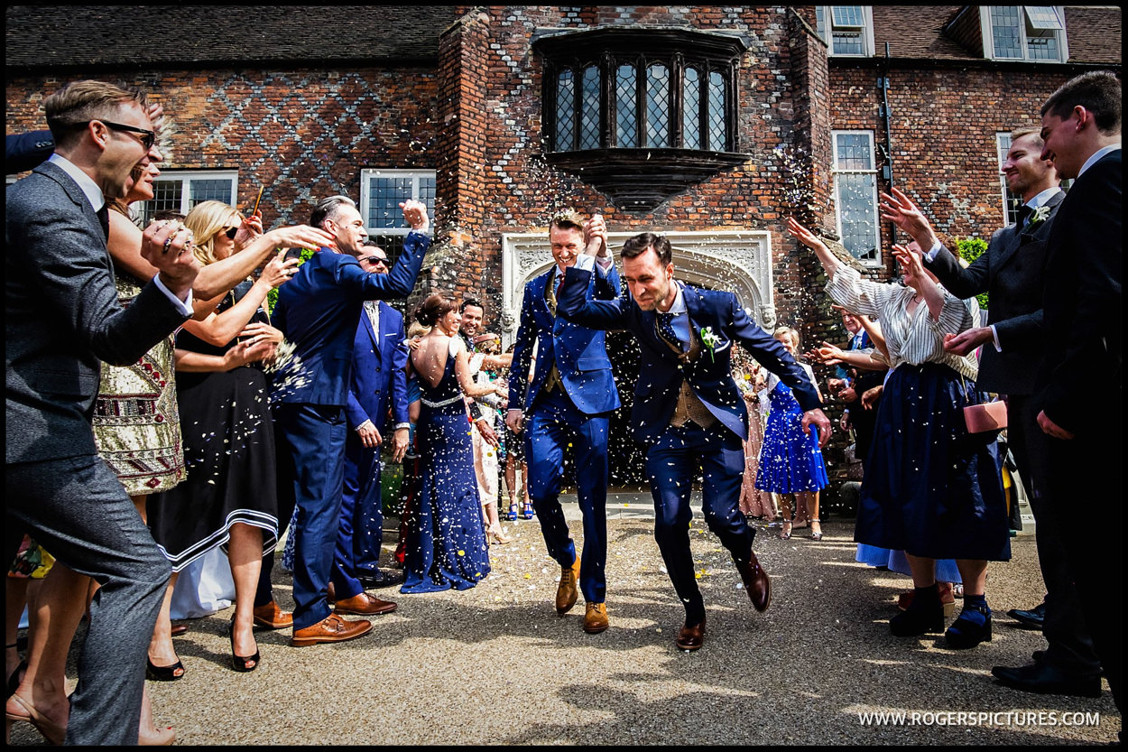 Grooms in confetti at Fulham Palace