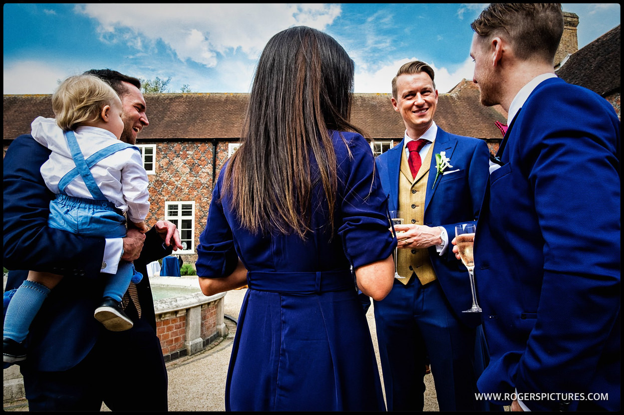 Guests in the courtyard at Fulham Palace wedding