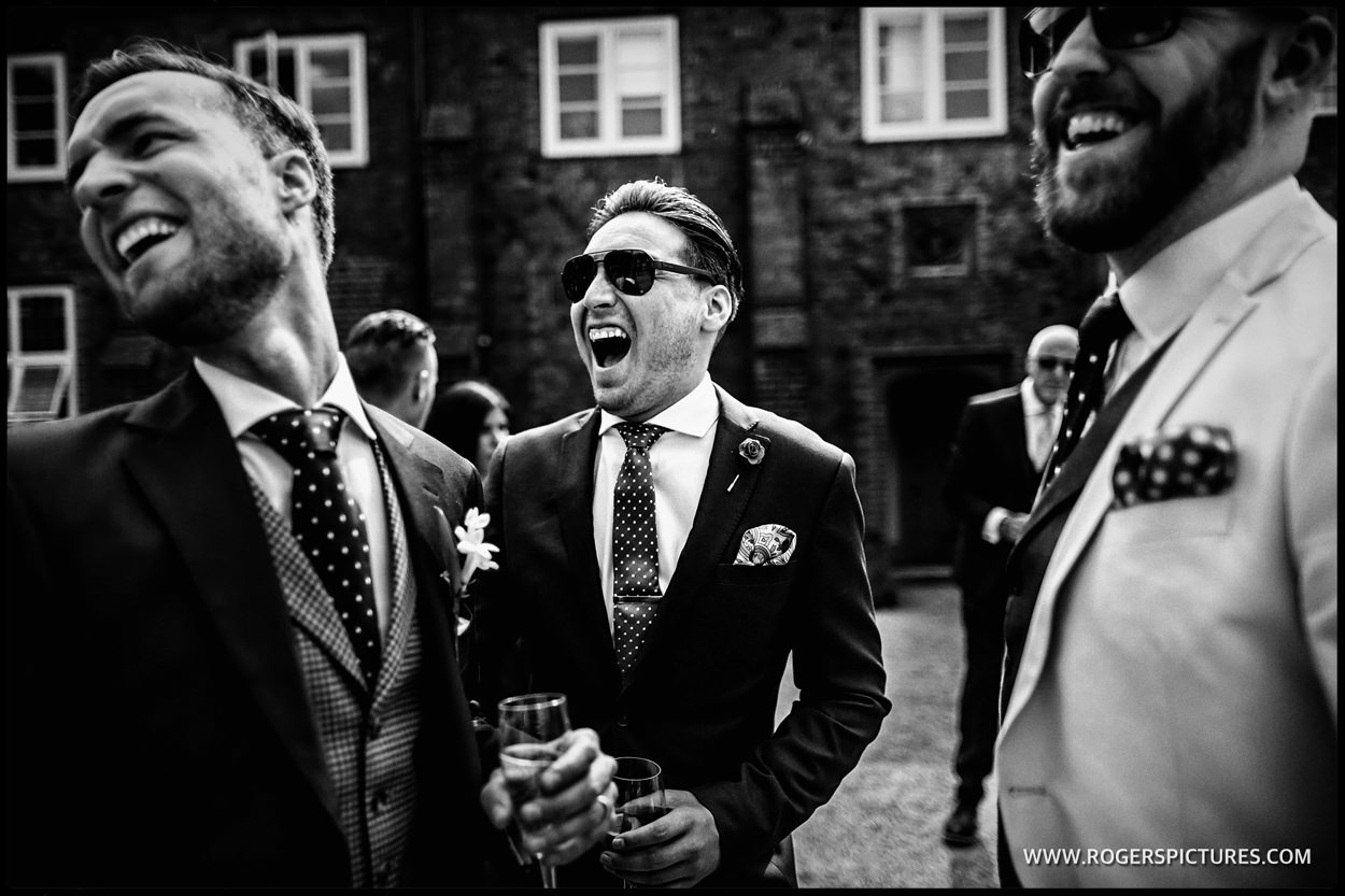 Laughing guests in black-and-white