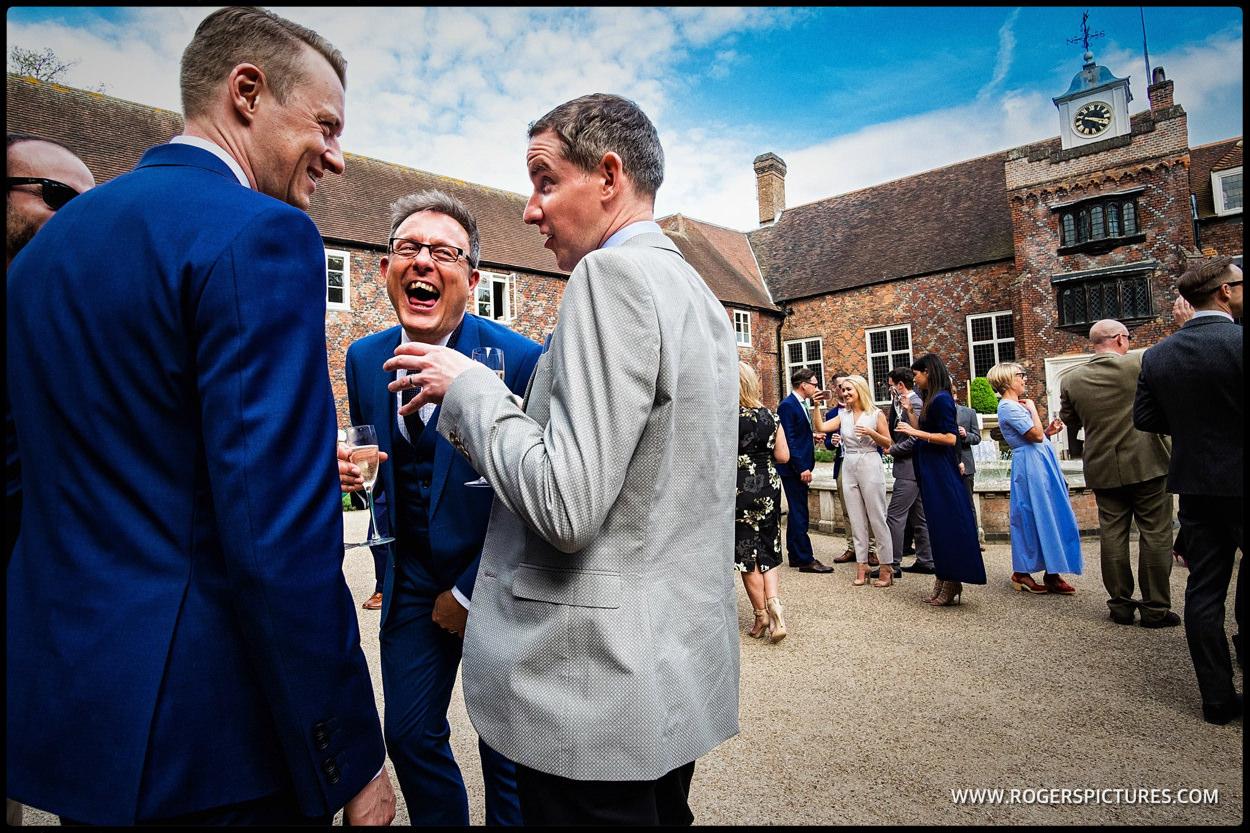 Guests enjoy jokes at Fulham Palace wedding