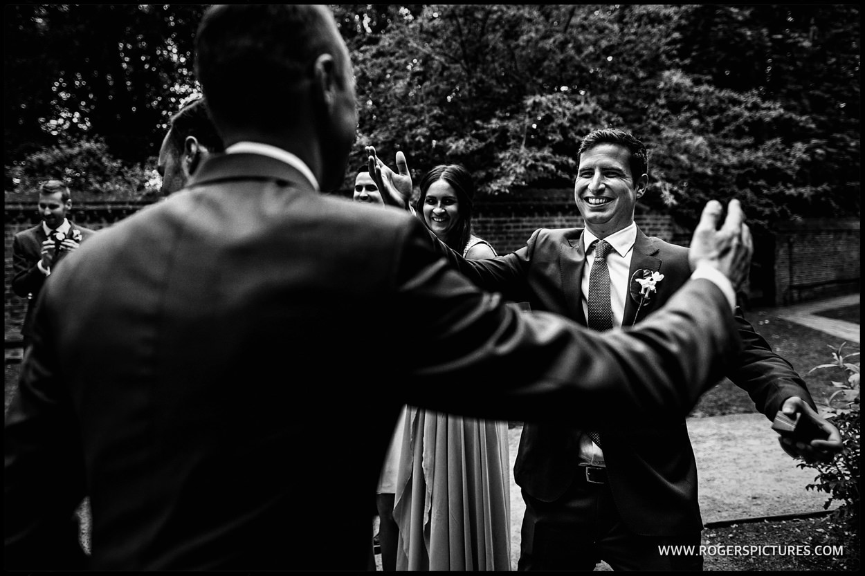 Friends greet each other during wedding ceremony celebrations