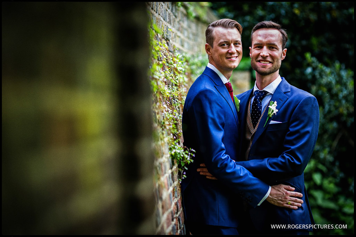 Gay wedding couple at Fulham Palace in London