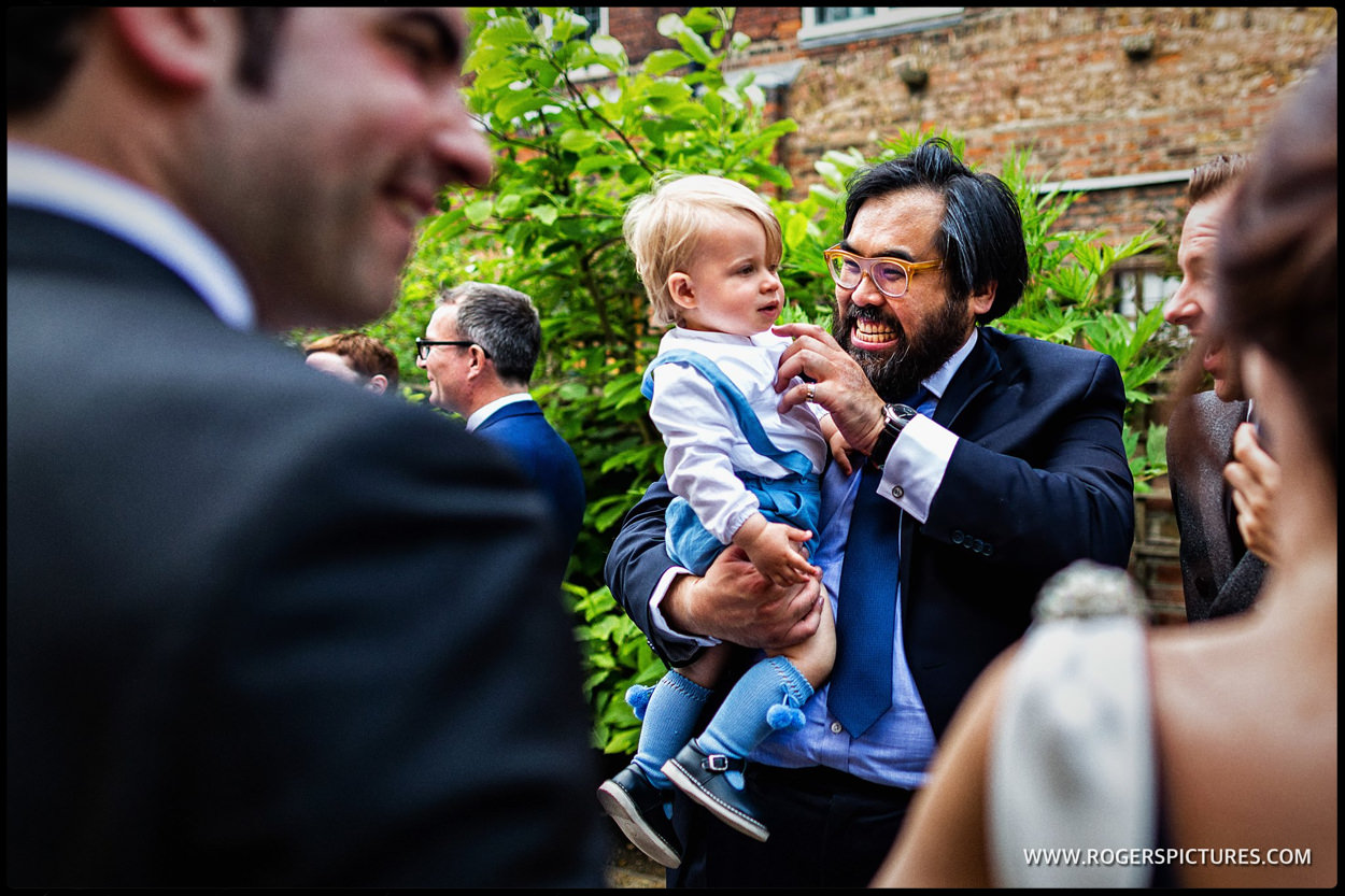 Wedding guest and child at London wedding