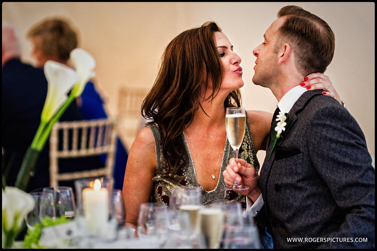 Happy wedding guests with champagne