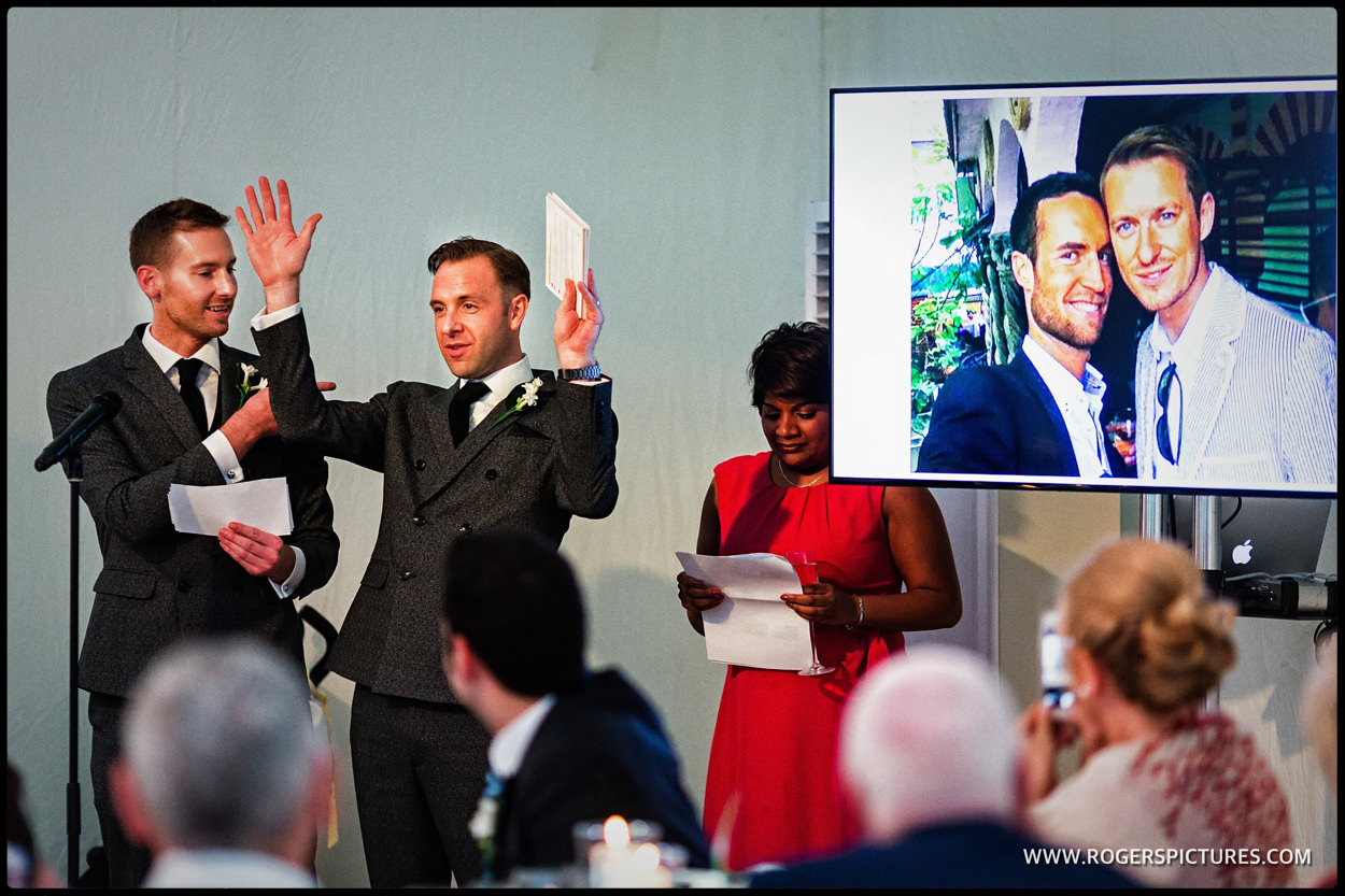 Two grooms during speeches at same-sex wedding