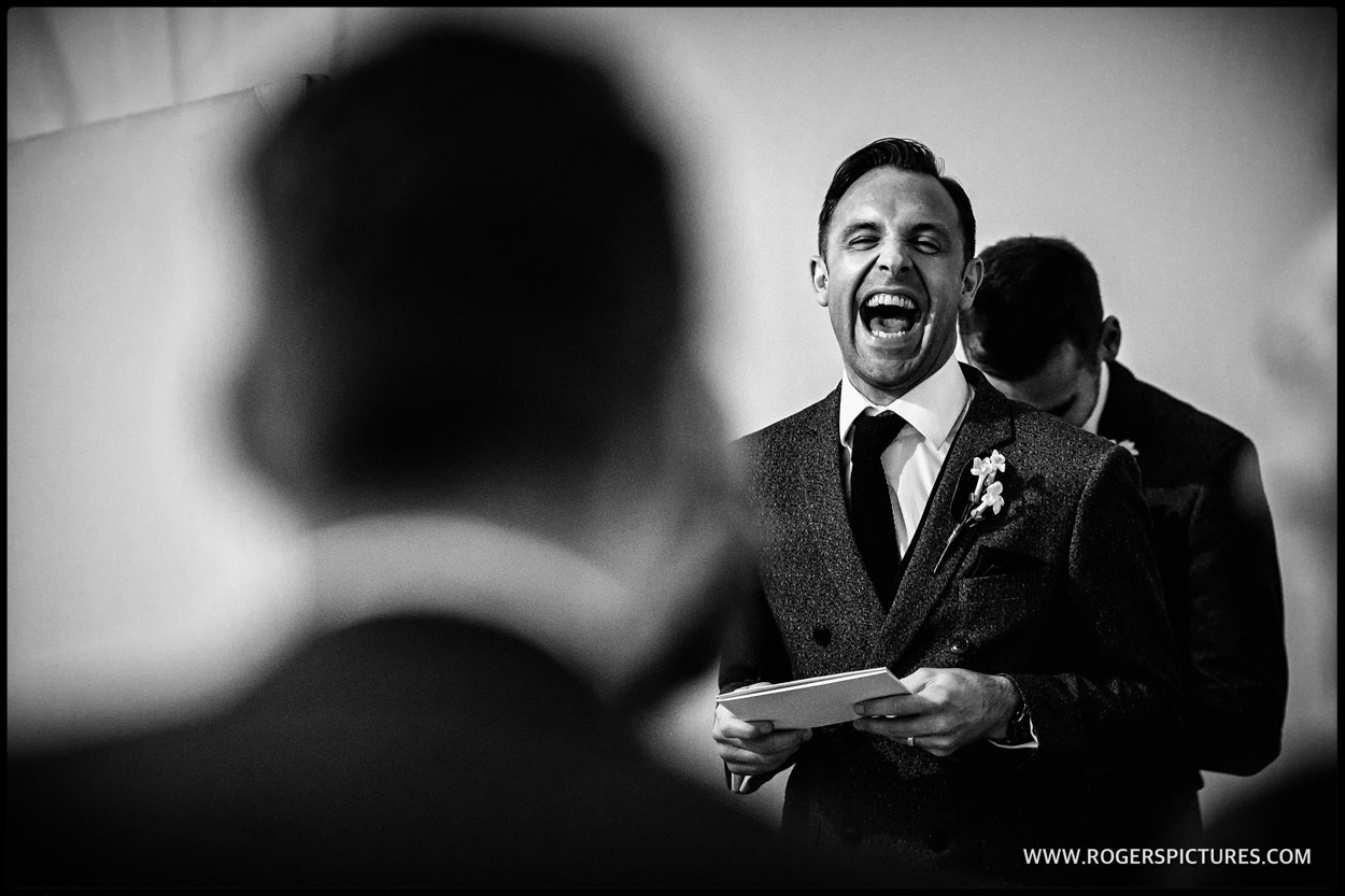 Laughing best man delivers speech
