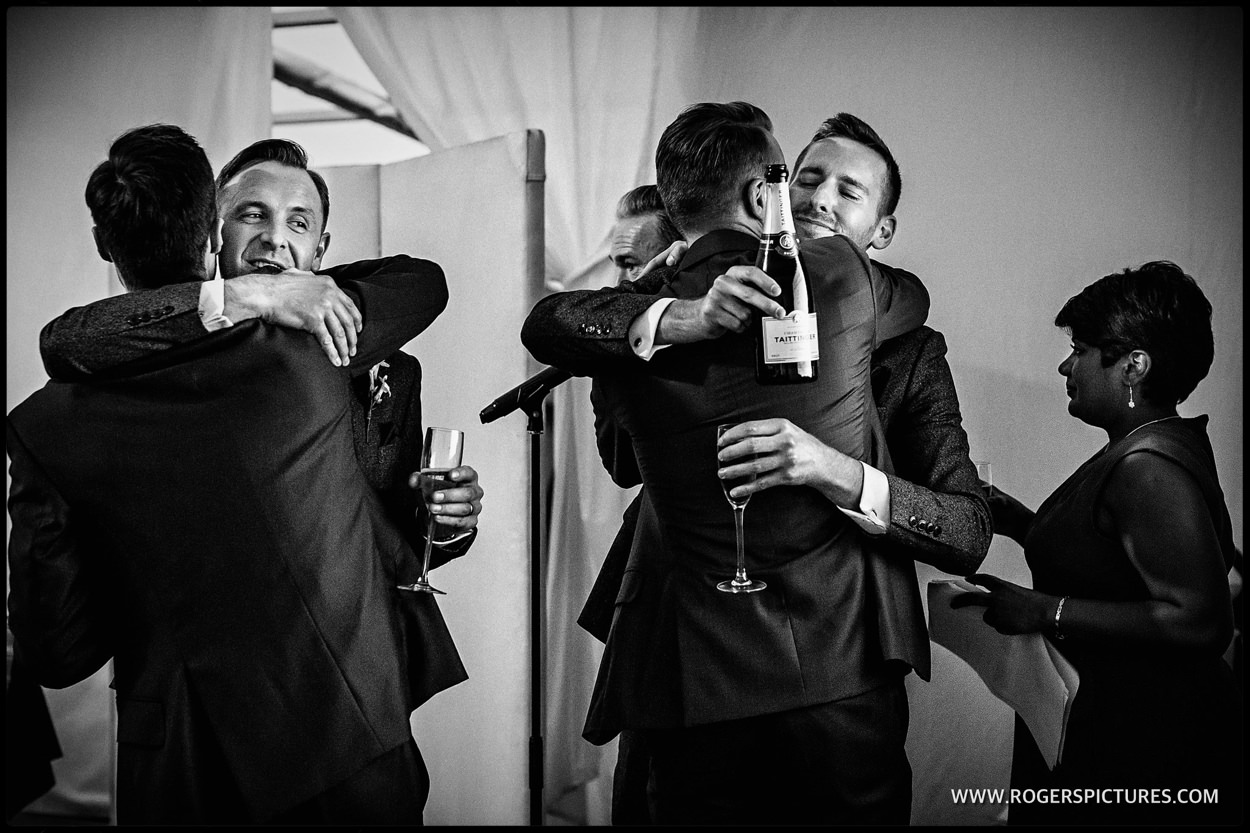 Hugs after wedding speeches at Fulham Palace in London