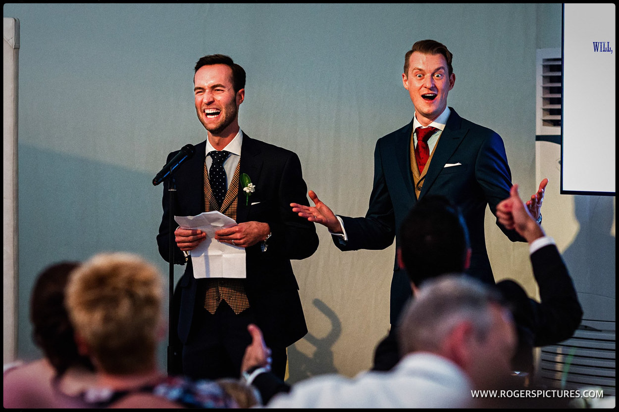 Grooms give a joint speech after wedding breakfast