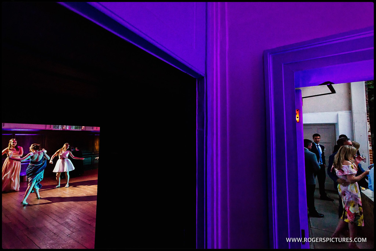Split composition of the dancefloor at a wedding reception