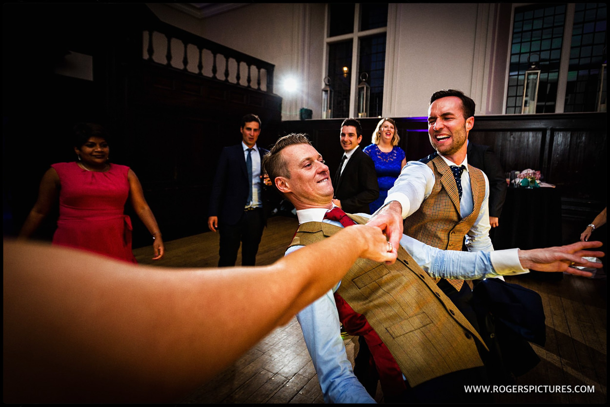 Same-sex grooms dancing at Fulham Palace wedding
