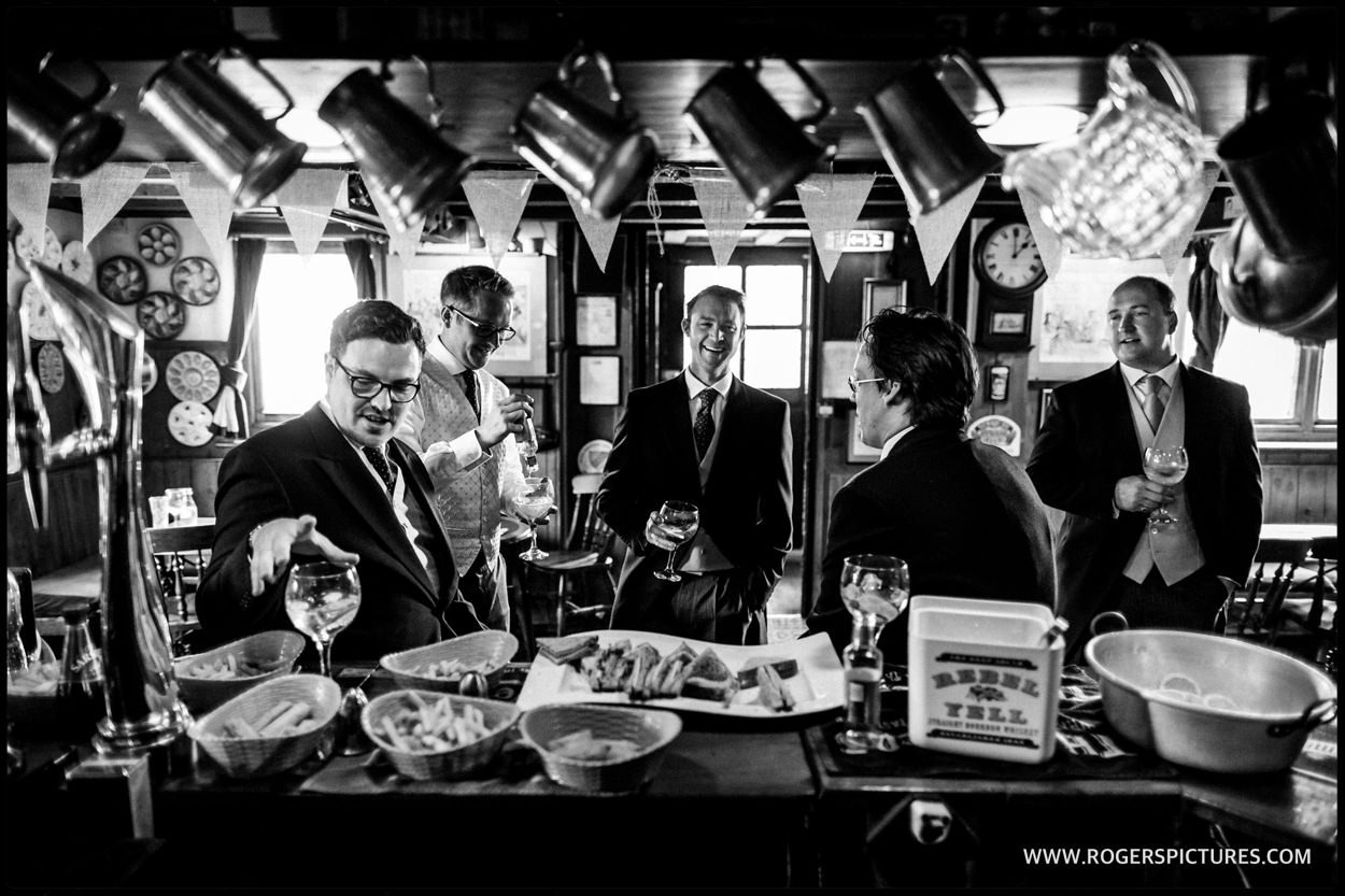 Groom and his friends having a drink before the wedding ceremony