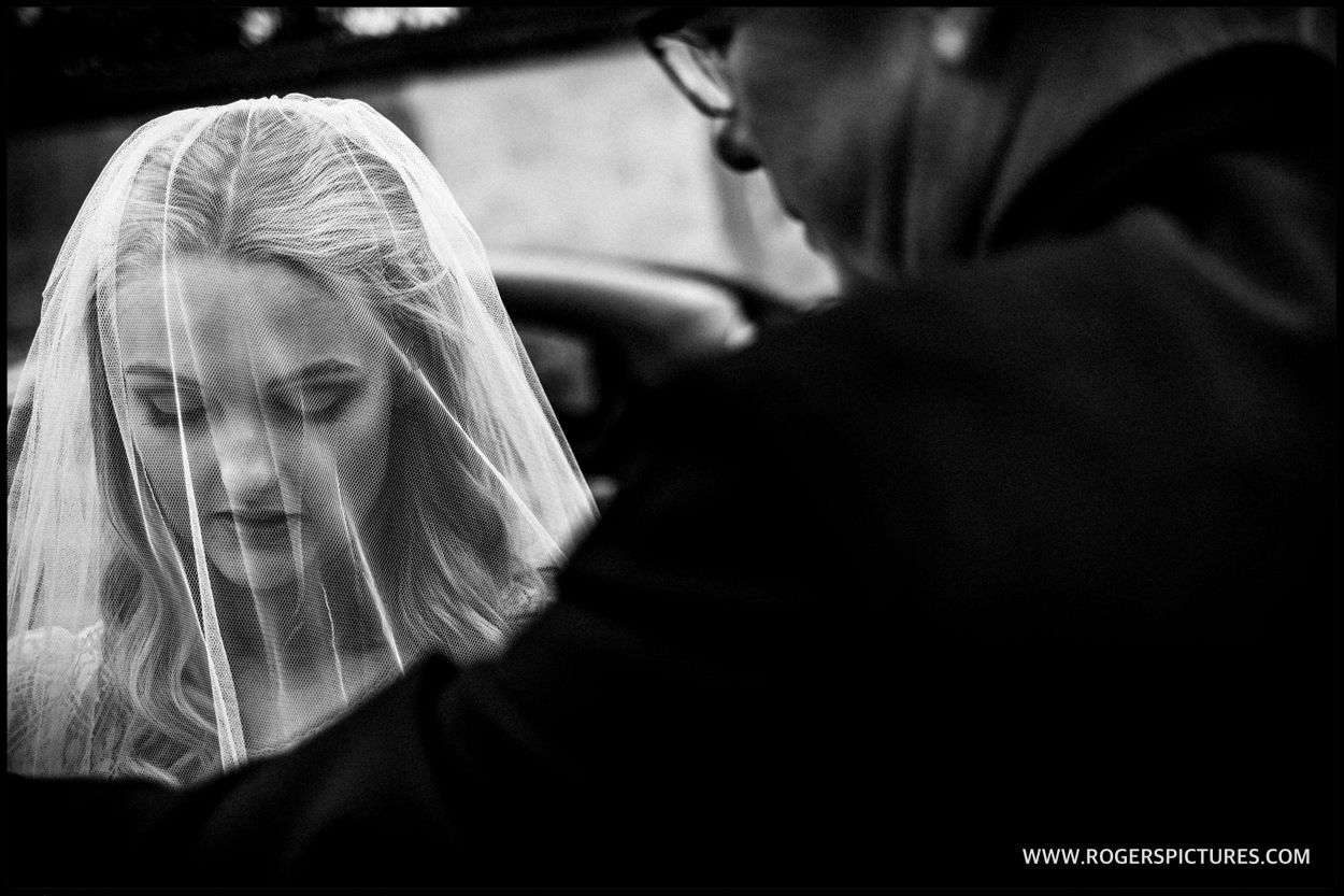 Veiled bride before Dorset marquee wedding