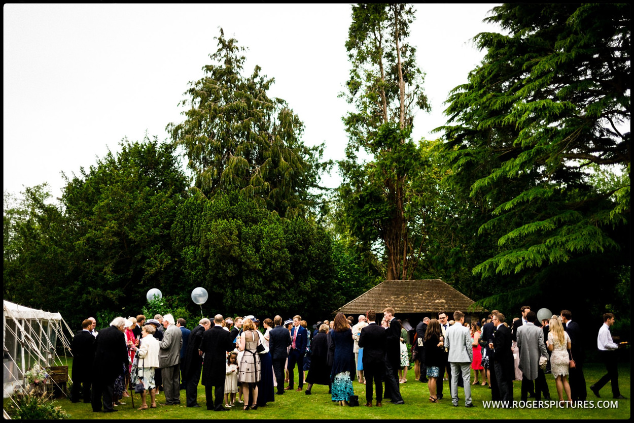 Guests in the garden at Dorset marquee wedding
