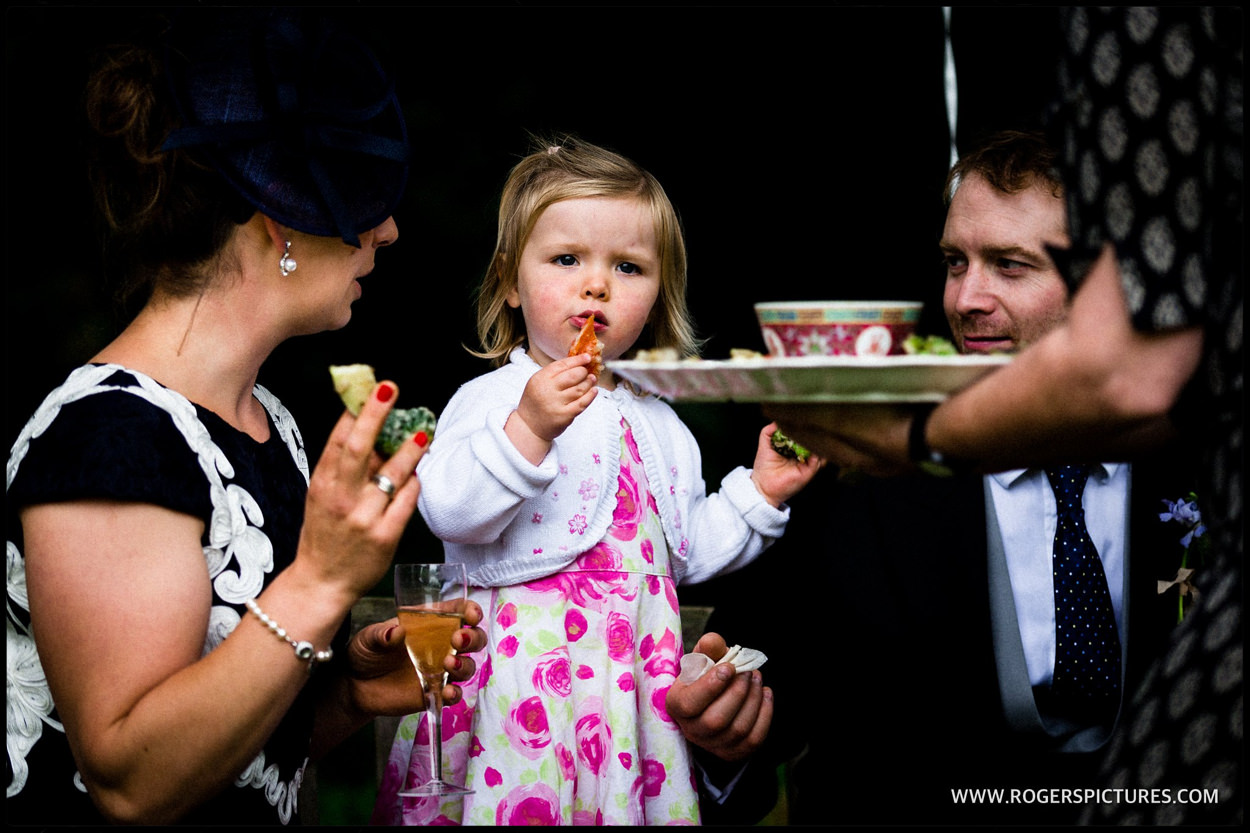 Young guest eating canapés at a wedding