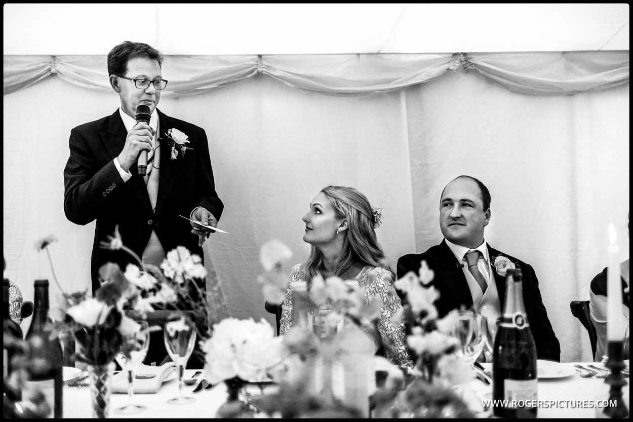 Father of the bride speaks at a marquee wedding