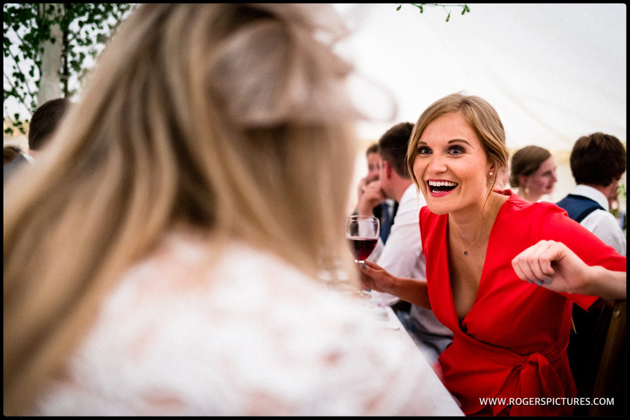 Wedding guest in red dress