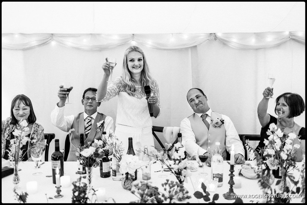 Toast from the bride at marquee wedding