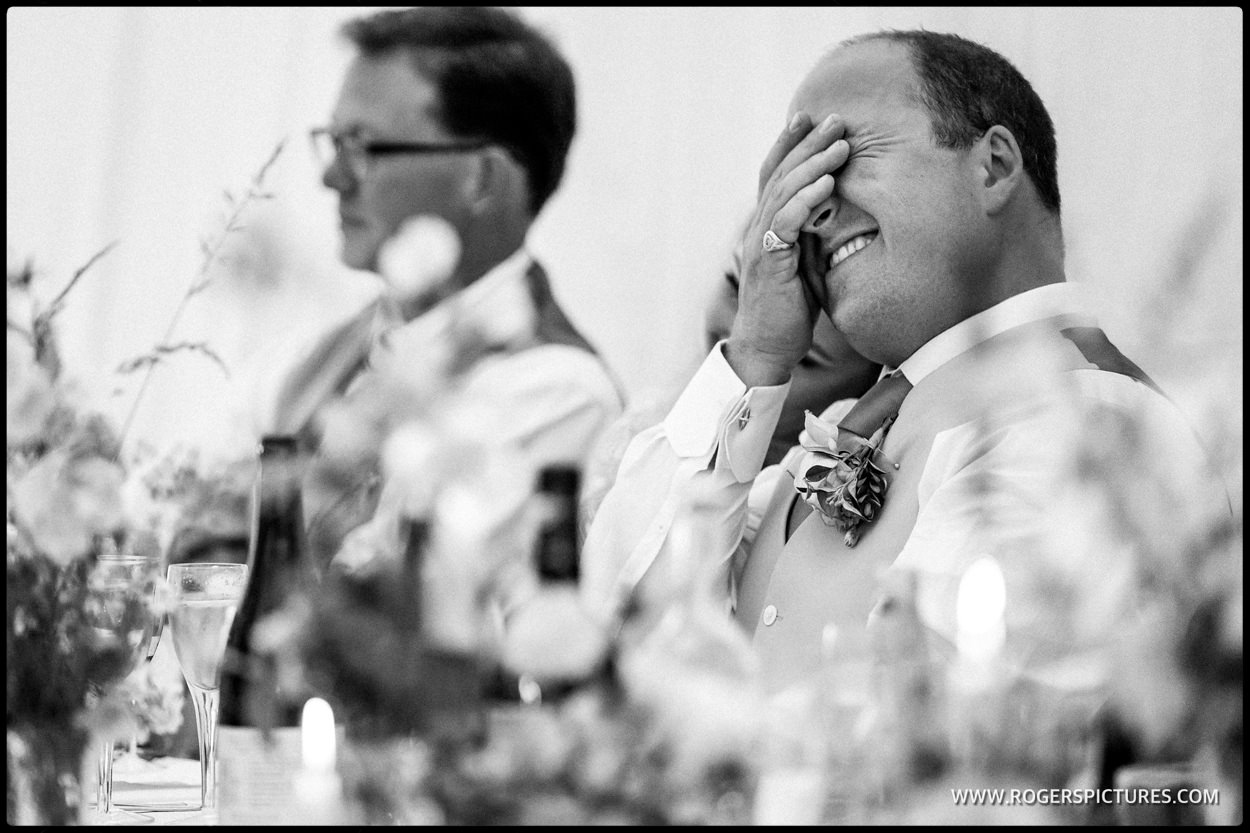 Groom cringes during best man speech