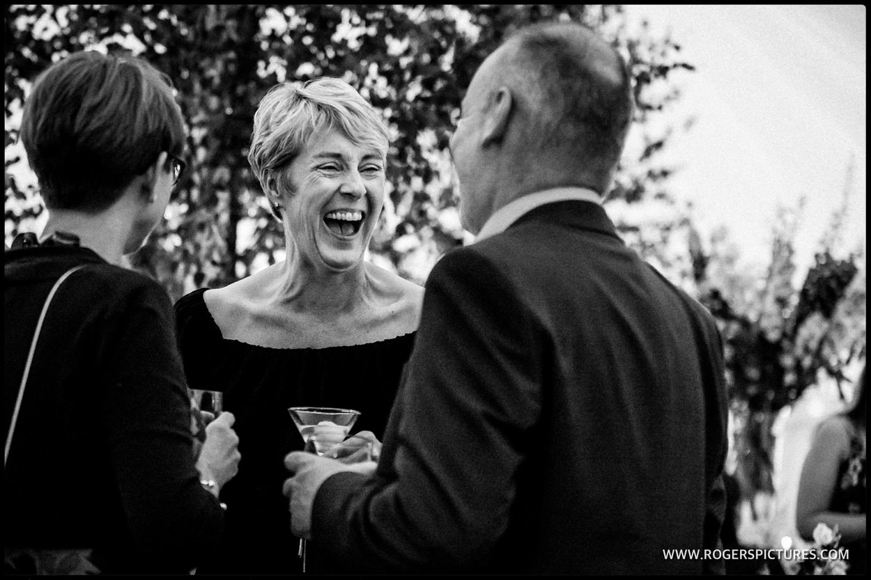 Laughing wedding guests after the speeches