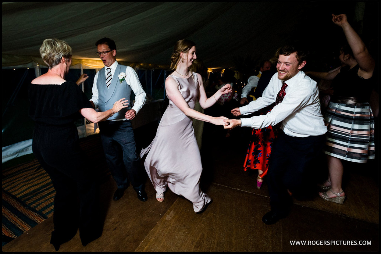 Guests on the dancefloor at a marquee wedding