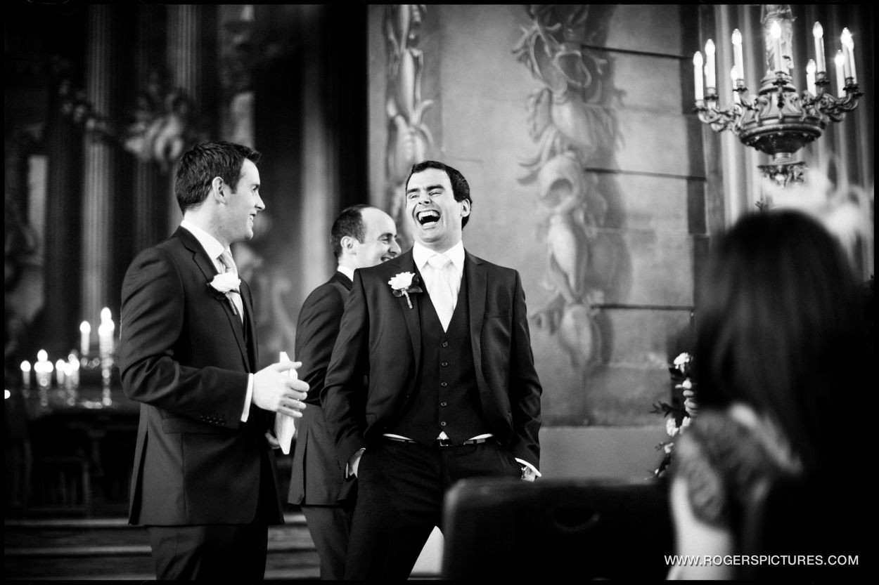 Groom laughing in Painted Hall Greenwich