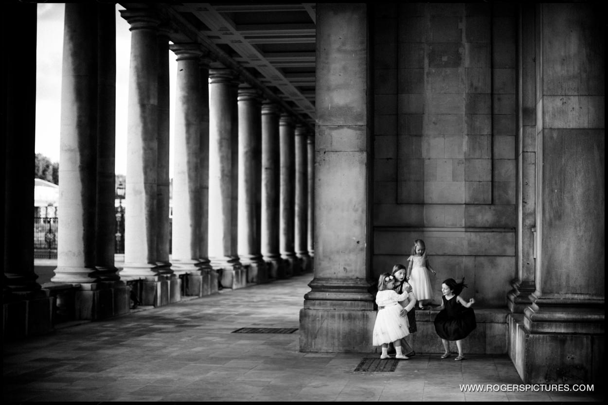 Children playing amongst the columns at the Old Royal Naval College in Greenwich