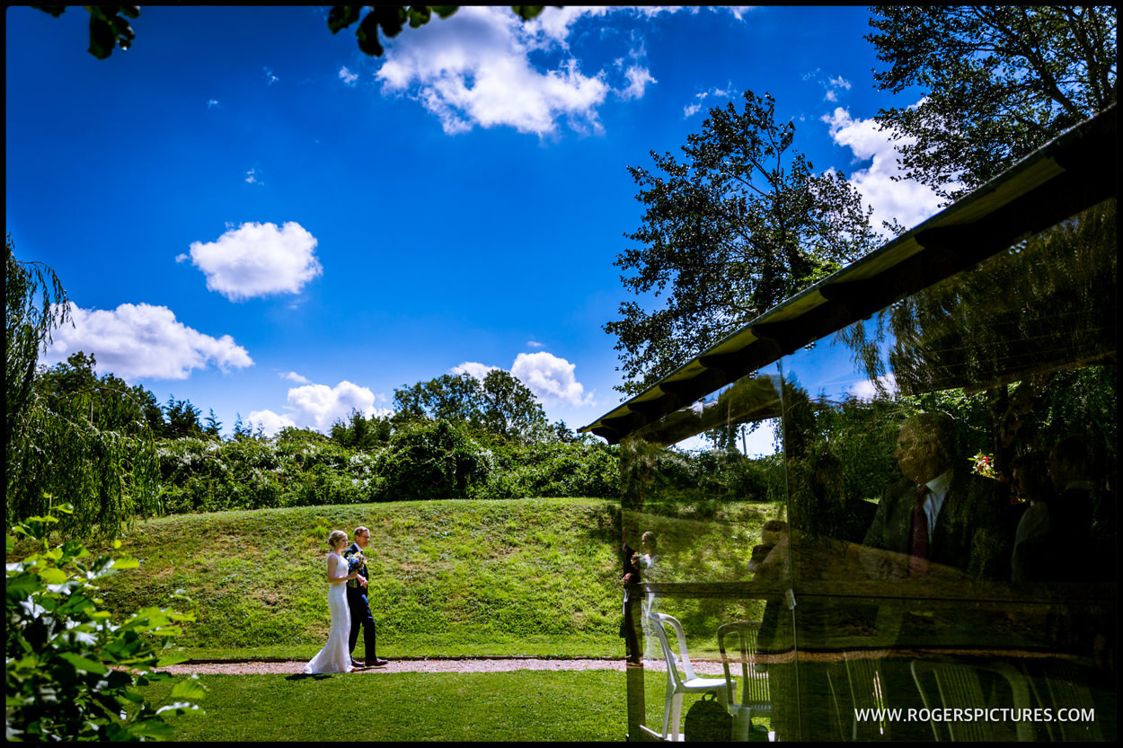 Bride and Father arrive at the Lake Pavilion for the wedding ceremony at Minstrel Court in Royston