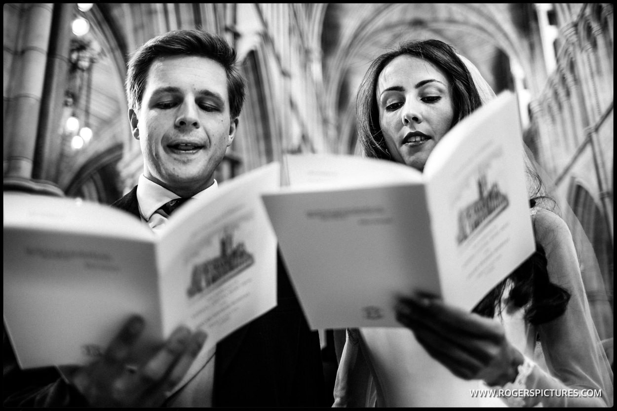 Bride and groom singing at Southwark Cathedral wedding