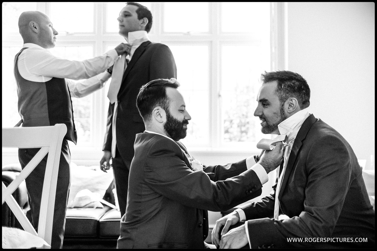 Groomsmen preparation before the Stolisma at a Greek Cypriot wedding